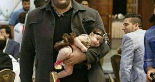 بچه بغل کردن به سبک بهداد سلیمی! +عکس