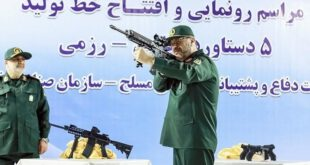 عکس: ژست وزیر دفاع با اسلحه های جدید