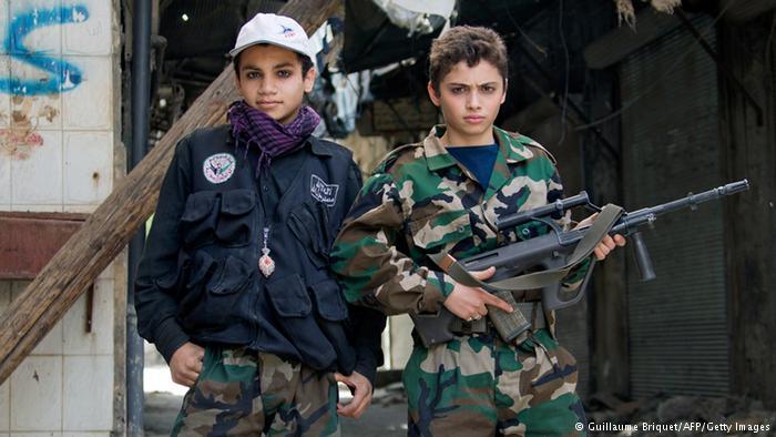 www.dustaan.com سوء استفاده جنسی و نظامی عناصر داعش از کودکان +تصاویر