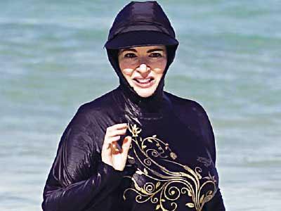 www.dustaan.com اعتراض زنانه به ممنوعیت شنا با لباس /عکس