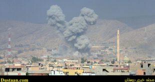 Дым над домами в городе Башика к югу от Мосула в Ираке