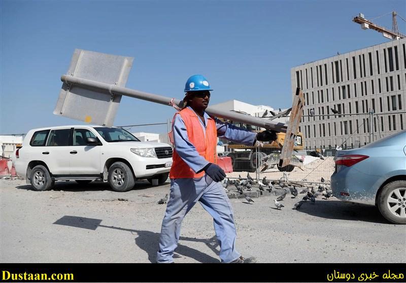 www.dustaan.com عکس: استفاده از کلاه های فن دار برای کارگران در قطر