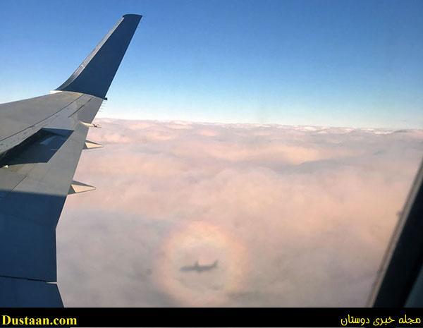 آموزش تصویری رولت بدون فر تصویری زیبا از یک هواپیما بر فراز ابرها