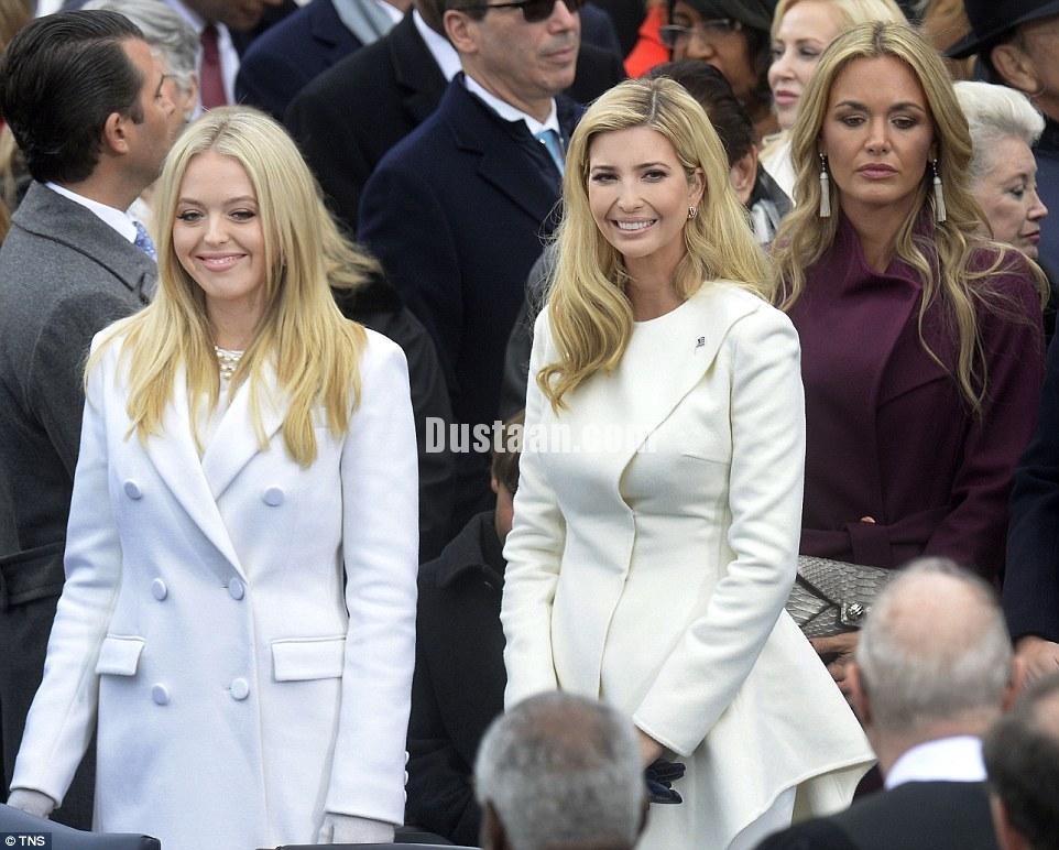 http://i.dailymail.co.uk/i/pix/2017/01/20/18/3C549F1600000578-4140410-Ivanka_and_Tiffany_s_elegant_white_coats_helped_them_stand_out_i-a-168_1484936014788.jpg