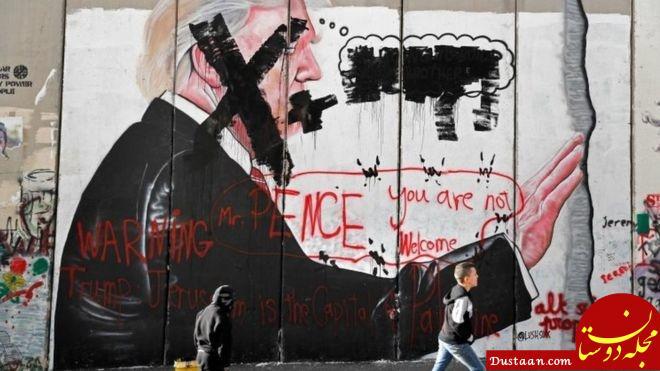 www.dustaan.com خطخطی کردن چهره ترامپ بر دیوار حائل بیتالمقدس و بیتاللحم + تصاویر