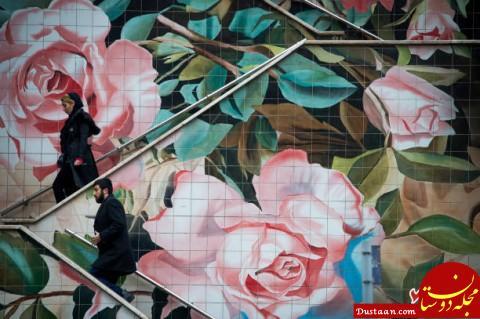 www.dustaan.com عکس بلومبرگ از نقاشی دیواری یک راه پله در تهران