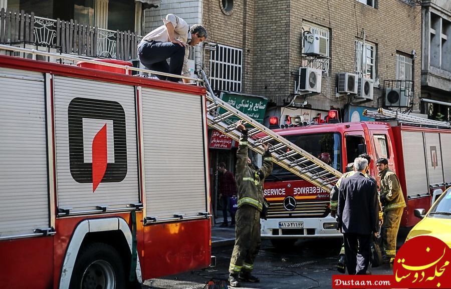 www.dustaan.com آتش سوزی گسترده فروشگاه تجهیزات پزشکی در خیابان ولیعصر(عج) +تصاویر