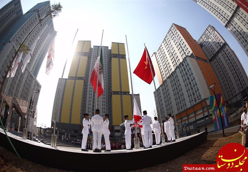 www.dustaan.com اهتزاز پرچم ایران در دهکده بازی های آسیایی +عکس