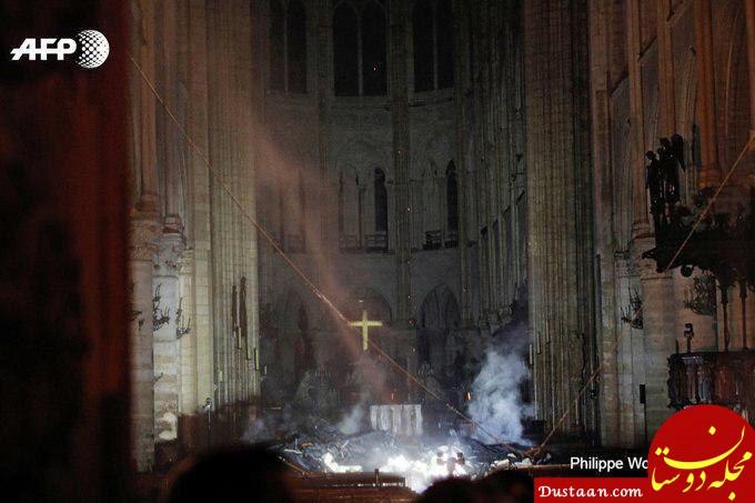 www.dustaan.com بهت و حیرت شهروندان پاریس از آتش سوزی کلیسای نوتردام